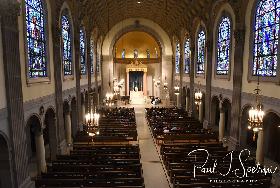 A wide view of the church during Brian & Sarah's June 2018 wedding ceremony at the College of the Holy Cross in Worcester, Massachusetts.