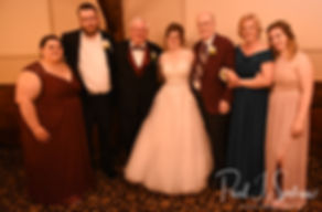 Kelly takes a photo with family members during her June 2018 wedding reception at Blissful Meadows Golf Club in Uxbridge, Massachusetts.