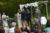 Ryan and Mike hold hands during their May 2018 wedding ceremony at Bittersweet Farm in Westport, Massachusetts.