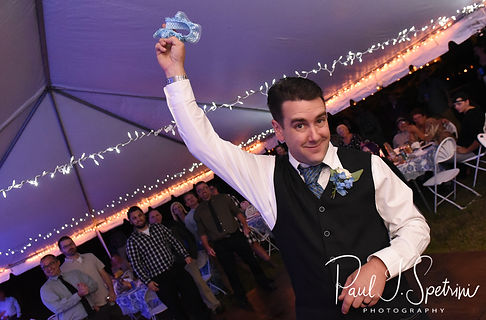 Josh gets ready to throw the garter during his September 2018 wedding reception at their home in Coventry, Rhode Island.