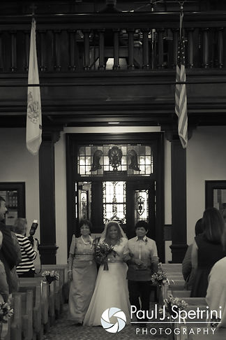 Lisajean walks down the aisle during her October 2016 wedding ceremony at St. Thomas More Church in Narragansett, Rhode Island.