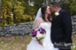 Stephanie and Henry kiss during a formal photo prior to their October 2016 wedding reception at Lake Pearl Luciano's in Wrentham, Massachusetts.