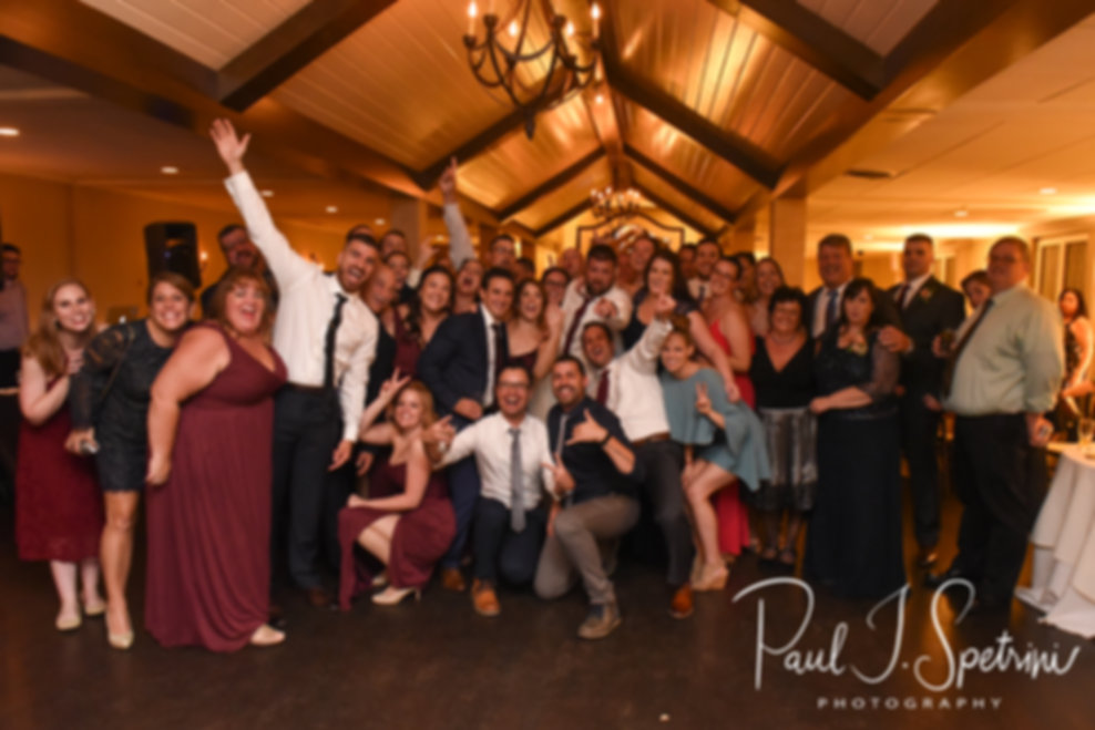 Katie and Steve pose for a photo with their guests during their October 2018 wedding reception at The Villa at Ridder Country Club in East Bridgewater, Massachusetts.