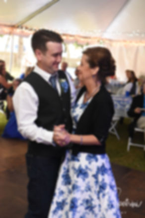 Josh and his mother dance during his September 2018 wedding reception at their home in Coventry, Rhode Island.