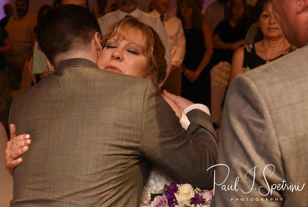 Robin and her son hug during her August 2018 wedding ceremony at Twelve Acres in Smithfield, Rhode Island.