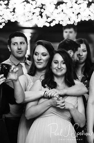 Dan's sisters look on as he and his mother dance during his September 2018 wedding reception at The Towers in Narragansett, Rhode Island.