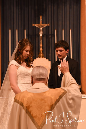 Brian and Sarah receive a blessing during their June 2018 wedding ceremony at the College of the Holy Cross in Worcester, Massachusetts.