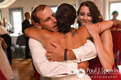 Heather and John share a hug with Heather's maid of honor during her July 2016 wedding reception at Crystal Lake Golf Club in Burrillville, Rhode Island.