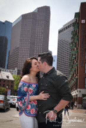 Nicole and Dan kiss during a photo in the North End neighborhood of Boston, Massachusetts during their May 2018 engagement session.
