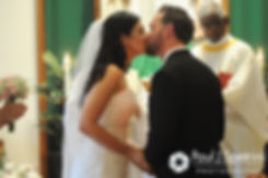 Justin and Lauryn share their first kiss during their July 2016 wedding at St. Paul the Apostle Catholic Church in Foster, Rhode Island.