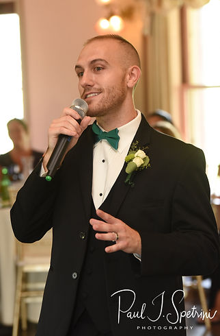 The best man gives a speech during Danielle & Mark's August 2018 wedding reception at the Roger Williams Park Casino in Providence, Rhode Island.