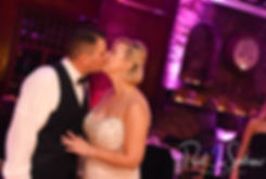 Brian and Meghan kiss during their September 2018 wedding reception at Squantum Association in Riverside, Rhode Island.