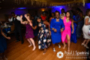 Guests dance during Jennifer and Mark's September 2016 wedding reception at the RI Shriners and Imperial Room at Rhodes Place in Providence, Rhode Island.