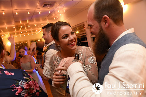 Arielle and Gary share a moment during their September 2017 wedding reception at North Beach Club House in Narragansett, Rhode Island.