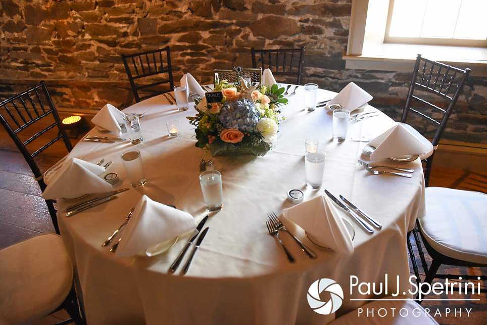 A look at the table settings for Bob and Debbie's June 2016 wedding reception at DeWolf Tavern in Bristol, Rhode Island.