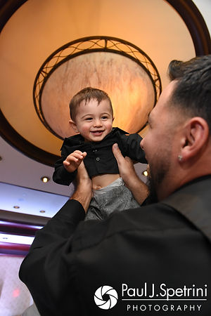 Dallas holds his son in the air during his September 2017 wedding reception at the Crowne Plaza Hotel in Warwick, Rhode Island.