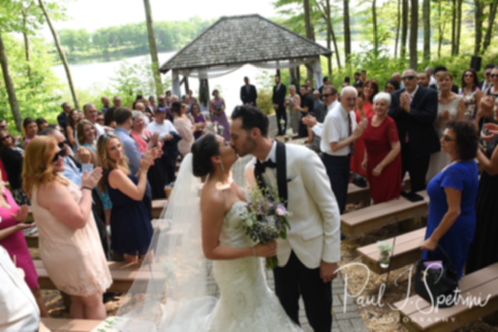Kendra & Joe kiss at the end of their aisle following their May 2018 wedding ceremony at Crystal Lake Golf Club in Mapleville, Rhode Island.