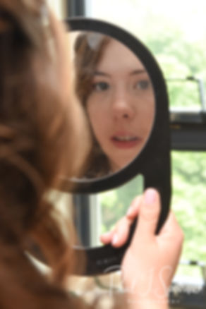 Sarah looks in the mirror prior to her June 2018 wedding ceremony at the College of the Holy Cross in Worcester, Massachusetts.
