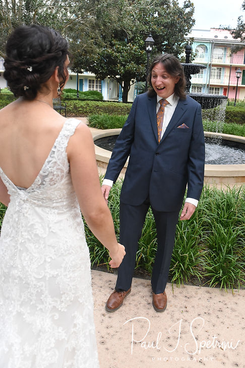 Amanda and Josh share a first look prior to their October 2018 wedding ceremony at the Walt Disney World Swan & Dolphin Resort in Lake Buena Vista, Florida.