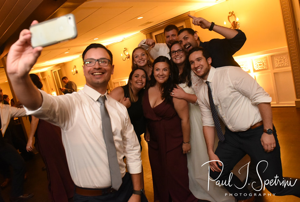 Guests pose for a photo during Katie & Steve's October 2018 wedding reception at The Villa at Ridder Country Club in East Bridgewater, Massachusetts.