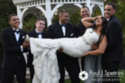 Stephany poses for a photo with the groomsmen following her September 2017 wedding ceremony at Wannamoisett Country Club in Rumford, Rhode Island.