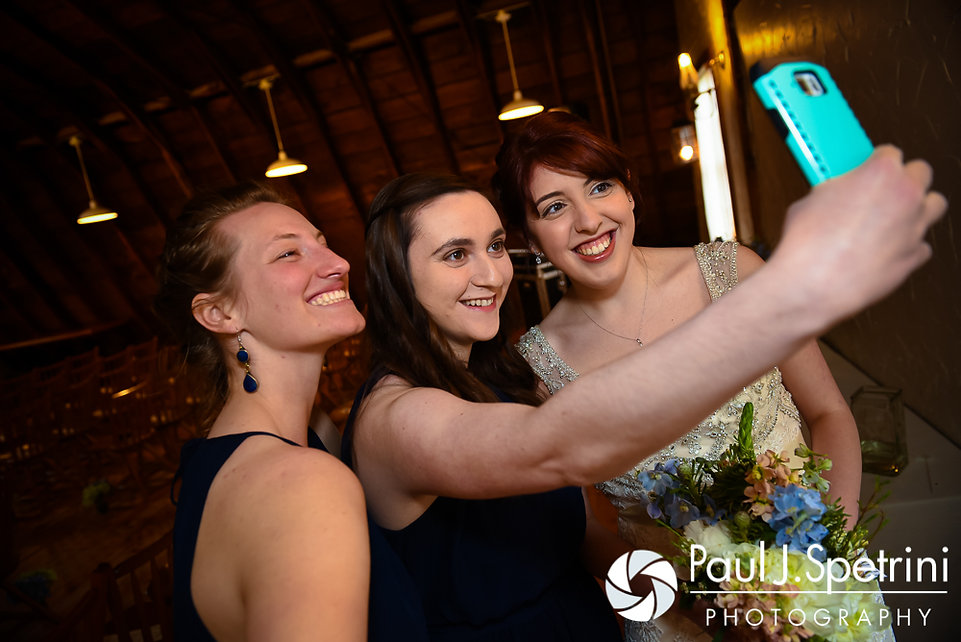 Ellen smiles for a photo with two of her bridesmaids prior to her May 2016 wedding at Bittersweet Farm in Westport, Massachusetts.