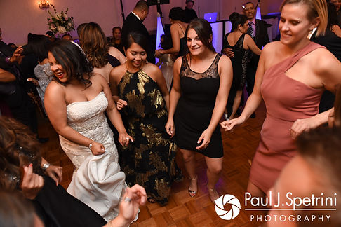 Stephany dances with guests during her September 2017 wedding reception at Wannamoisett Country Club in Rumford, Rhode Island.