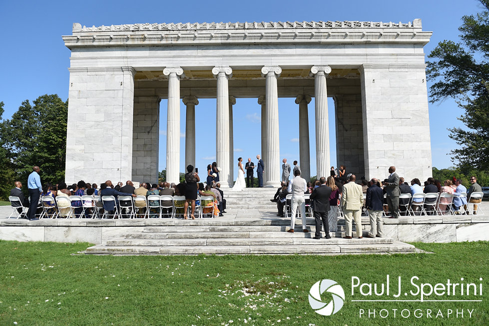 Jennifer and Mark stand in front of their friends and family members during their September 2016 wedding at the Roger Williams Park Temple of Music in Providence, Rhode Island.