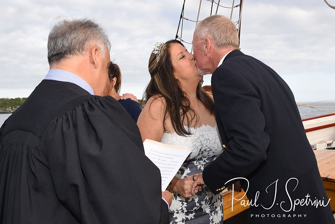 Mike and Kate kiss during their May 2018 wedding ceremony aboard the Schooner Aurora boat in the waters off Newport, Rhode Island.