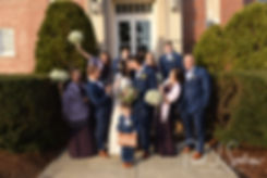 Stacey and Mack kiss in a photo with their wedding party following their December 2018 wedding ceremony at St. Teresa's Church in Attleboro, Massachusetts.