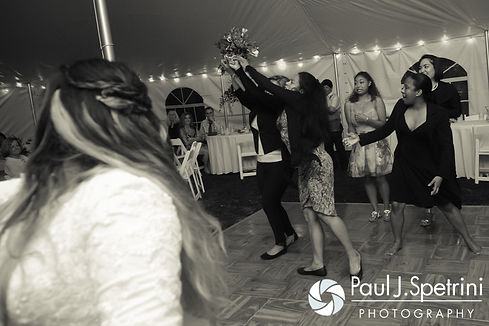 Lisajean tosses her bouquet during her October 2016 wedding reception in Charlestown, Rhode Island.