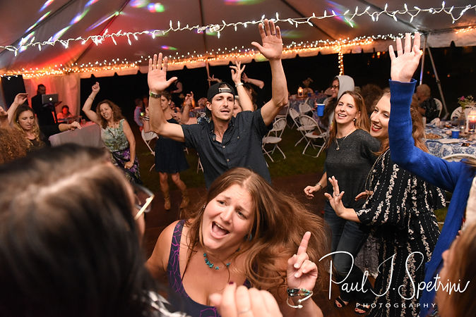 Guests dance during Josh & Kim's September 2018 wedding reception at their home in Coventry, Rhode Island.