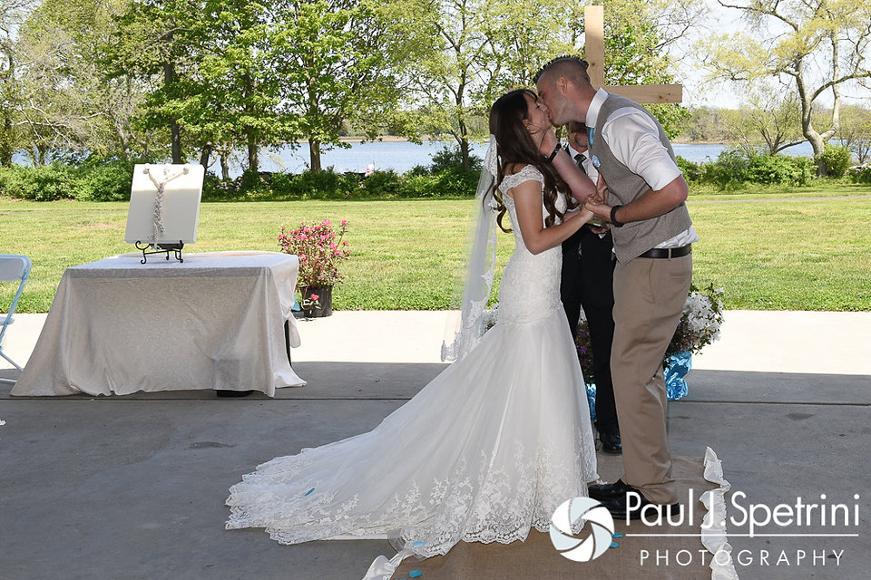 Krystal and Ian share their first kiss during their May 2016 wedding at Colt State Park in Bristol, Rhode Island.