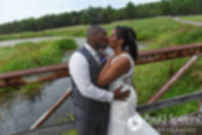 Kemi and Warren kiss for a formal photo following their August 2016 wedding reception at the Villa at Riddler Country Club in East Bridgewater, Massachusetts.