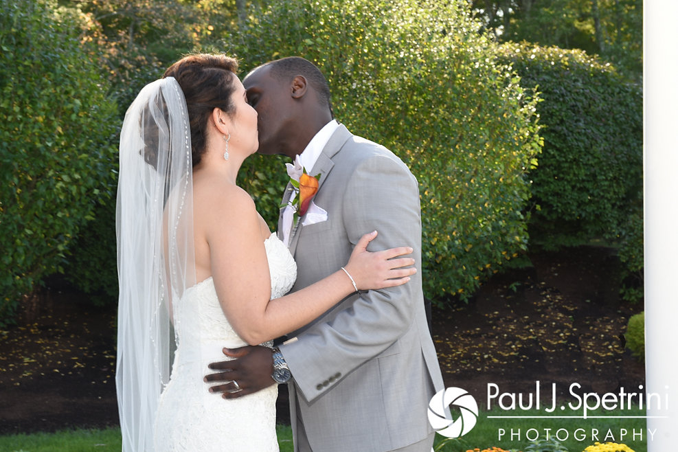 Kevin and Kristina share their first kiss during their October 2017 wedding ceremony at the Villa Ridder Country Club in East Bridgewater, Massachusetts.