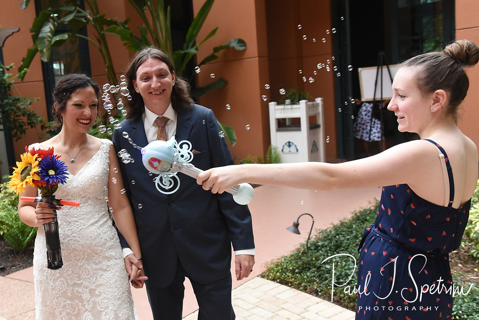 Amanda and Josh return to cocktail hour following their October 2018 wedding ceremony at the Walt Disney World Swan & Dolphin Resort in Lake Buena Vista, Florida.