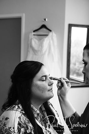 Katie has her makeup applied during bridal prep prior to her October 2018 wedding ceremony at The Villa at Ridder Country Club in East Bridgewater, Massachusetts.