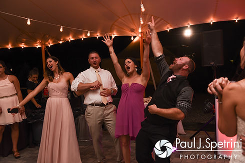 Guests dance during Lauryn and Justin's July 2016 wedding reception at the Overlook at Geer Tree Farm in Griswold, Connecticut.