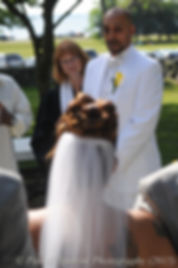 Joe Andrade watches his soon-to-be wife Jean come down the aisle.