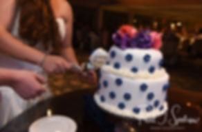 Laura & Marijke cut their wedding cake during their June 2018 wedding reception at Independence Harbor in Assonet, Massachusetts.