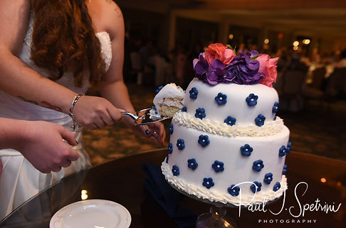 Laura & Marijke cut their wedding cake during their June 2018 wedding reception at Independence Harbor in Assonet, Massachusetts.