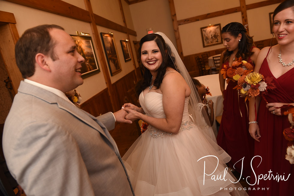 Makayla reapplies Rich's ring following their October 2018 wedding ceremony at Zukas Hilltop Barn in Spencer, Massachusetts.