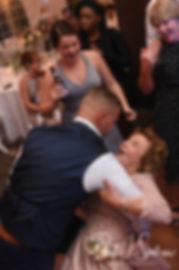 Guests dance during Amanda & Justin's November 2018 wedding reception at Five Bridge Inn in Rehoboth, Massachusetts.