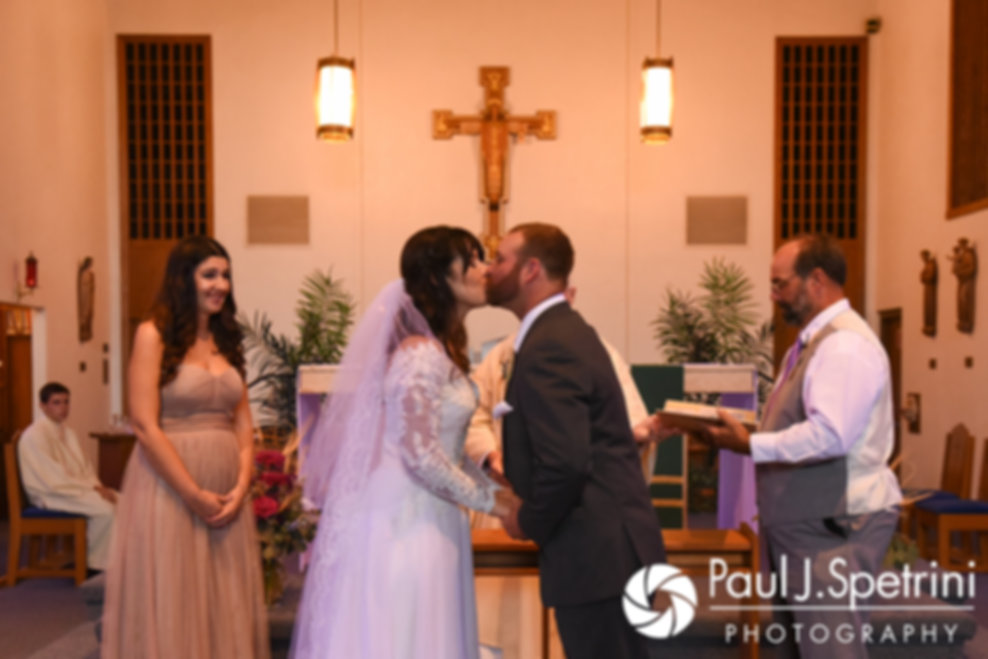 Samantha and Dale kiss during their October 2017 wedding ceremony at St. Robert's Church in Johnston, Rhode Island.