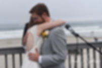 Justin and Amber hug during their June 2018 wedding ceremony at North Beach Clubhouse in Narragansett, Rhode Island.