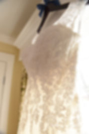 A look at Nicole's wedding dress as it hangs during her bridal prep session at the Publick House Historic Inn in Sturbridge, Massachusetts.
