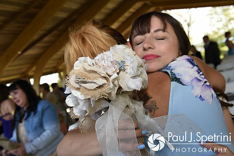 Krystal hugs a family member following her May 2016 wedding at Colt State Park in Bristol, Rhode Island.