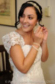 Emma puts her earrings in prior to her November 2015 wedding at the Publick House in Sturbridge, Massachusetts.