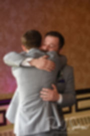 Sam hugs his brother during his April 2018 wedding reception at Quidnessett Country Club in North Kingstown, Rhode Island.