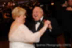 Cathy and Ron dance during their December 2015 Rhode Island wedding at Quidnessett Country Club in North Kingstown, Rhode Island.